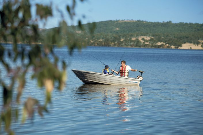 Man and son on fishing boat at Leslie Dam