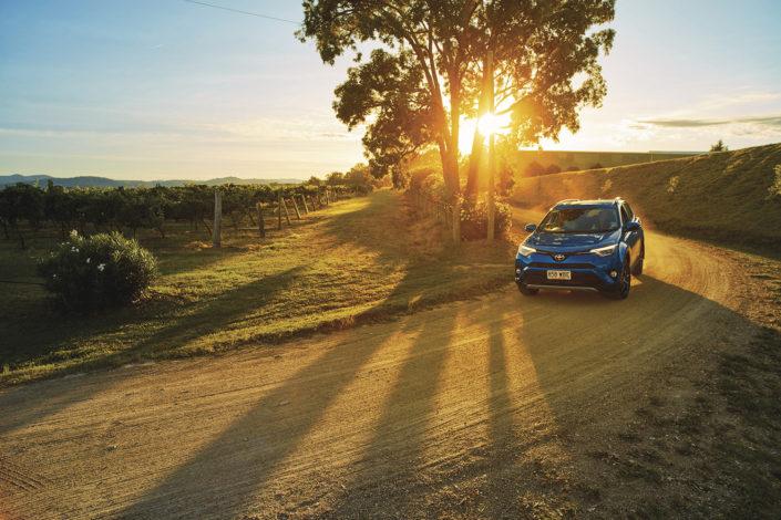 Car driving through the sunset