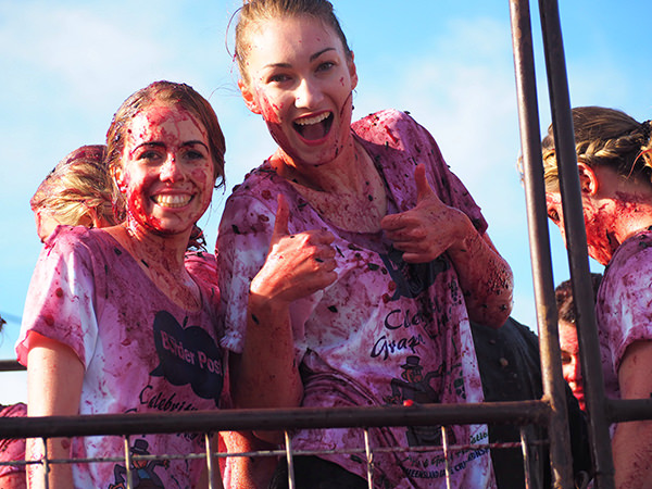 Two girls celebrating at the Apple and Grape Festival