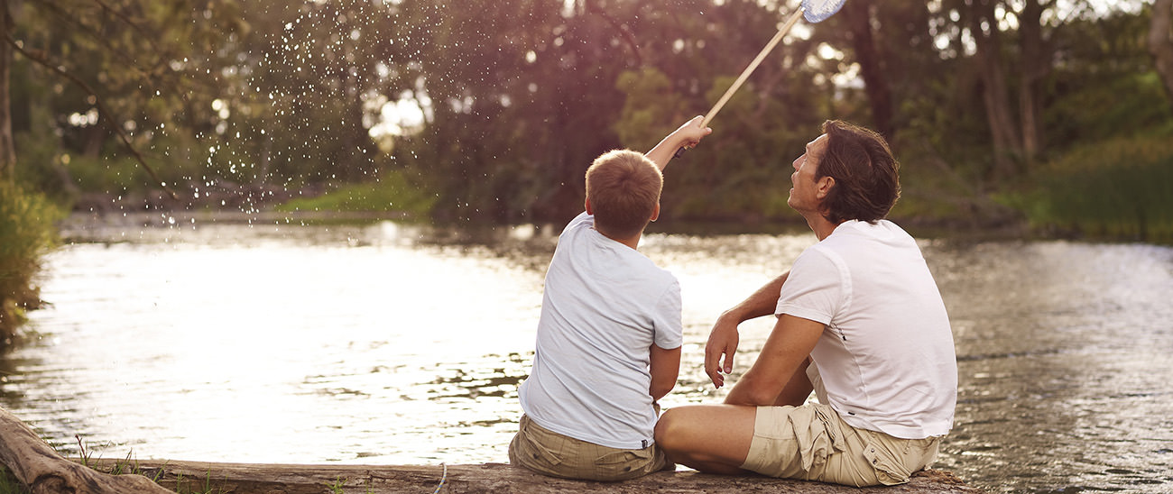 Father and son playing on the Condamine River
