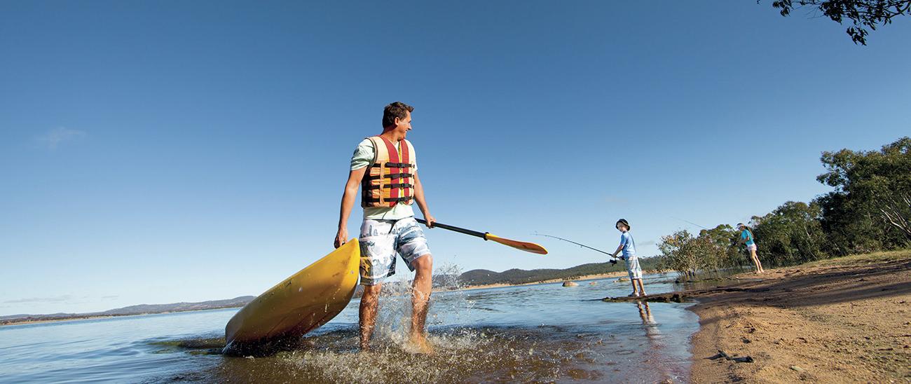 MAn canoeing in Leslie Dam