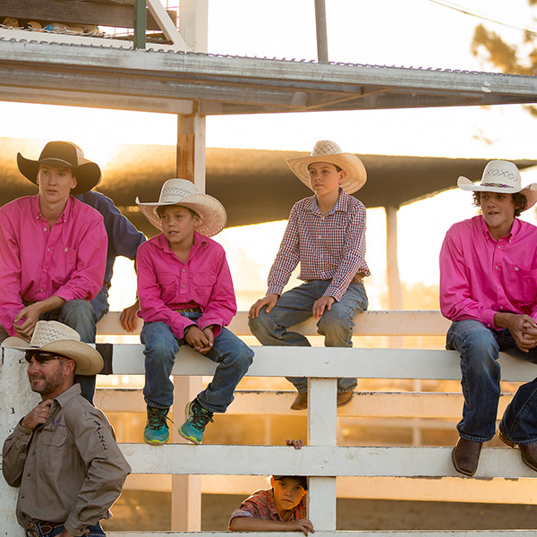 Rodeo riders watching on at rodeo
