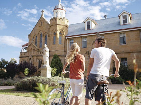 Couple biking near Abbey of the Roses in Warwick