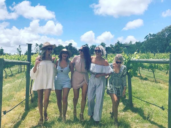 Girls in a vineyard on a Granite Belt wine tour