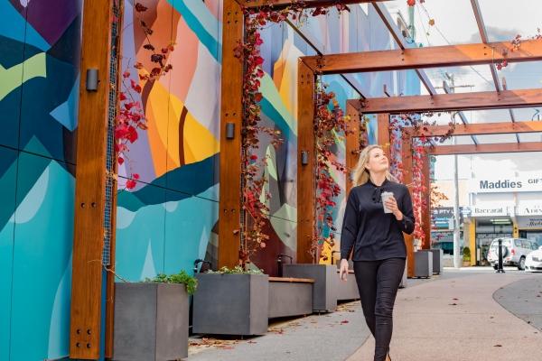 lady walking through an art mural in Stanthorpe